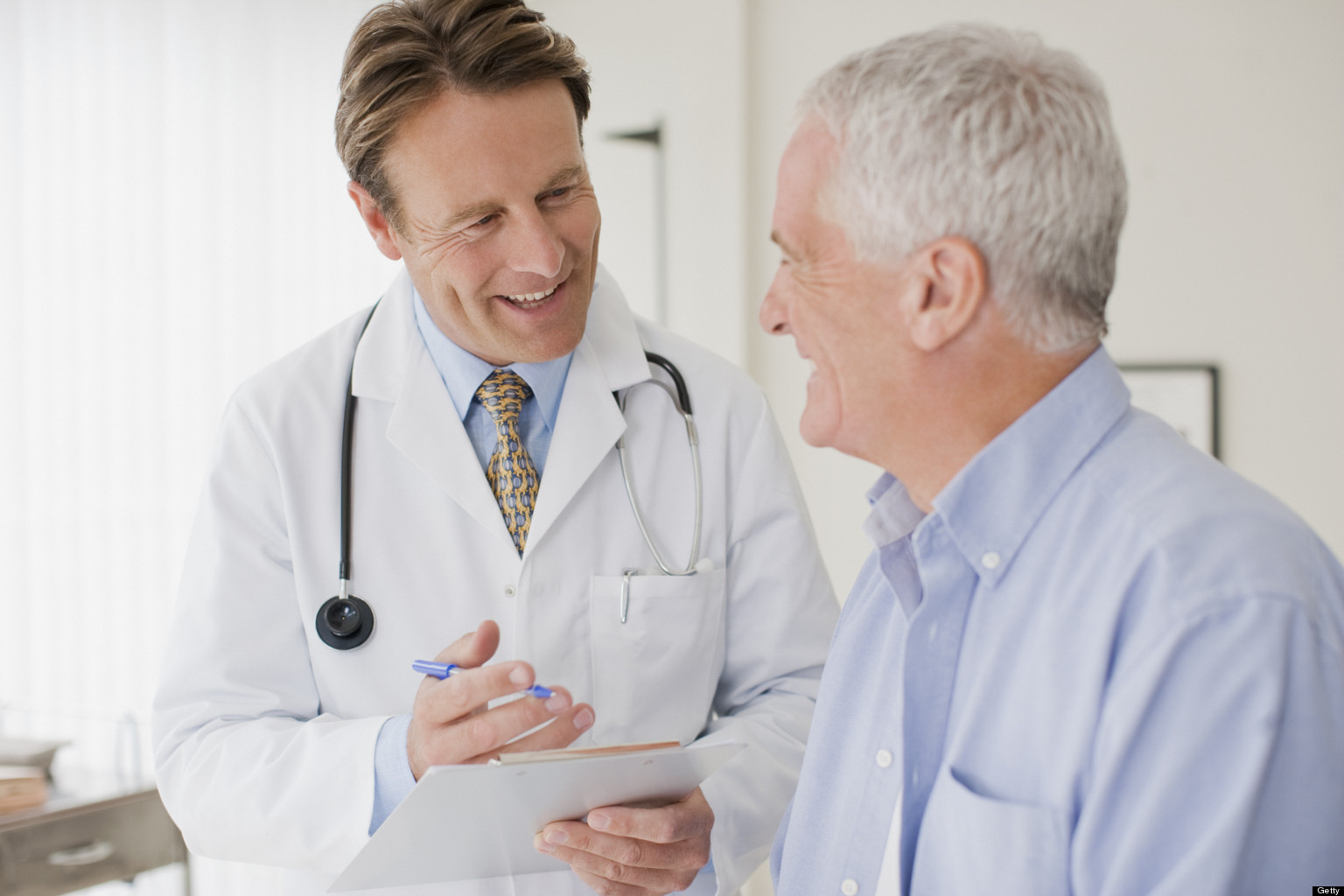Doctor talking with patient in doctors office